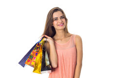 Smiling young girl stands up straight and keeps the color on the shoulder bags isolated  white background Royalty Free Stock Images