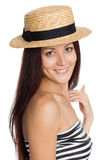 Smiling young girl in a straw hat Stock Photography