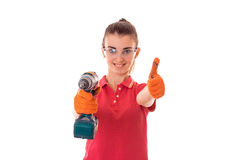 Smiling young girl is stretched out in a hand drill and shows the class of isolated on white background Stock Photos