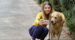 Young girl taking selfie with her dog 4k