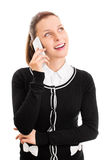 Smiling young girl talking on a phone Stock Image