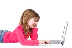 Smiling young girl typing on laptop Royalty Free Stock Photography