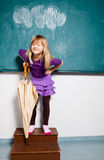 Smiling young girl with umbrella indoors Royalty Free Stock Photos