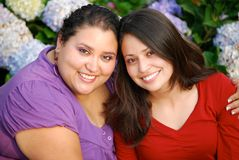 Smiling young girlfriends. Portrait of two smiling young Hispanic girlfriends outdoors Royalty Free Stock Photo
