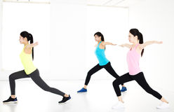 Smiling young  group stretching in gym Royalty Free Stock Photo