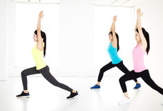 Smiling young  group stretching in gym Royalty Free Stock Photography