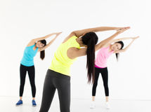 Smiling young  group stretching in gym Royalty Free Stock Image