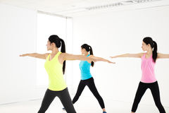 Smiling young  group stretching in gym Royalty Free Stock Images