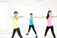 Smiling young  group stretching in gym Stock Image