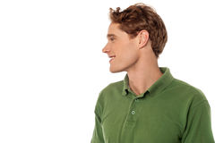 Smiling young guy looking away Stock Photo