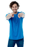Smiling young guy pointing at you Royalty Free Stock Photography