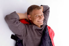 Smiling young guy posing in sleeping bag Stock Images