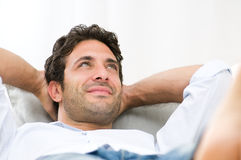 Smiling young guy relaxing Royalty Free Stock Photo