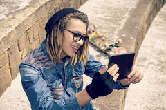 Smiling young guy with tablet  Stock Photo