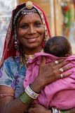 Smiling young gypsy woman and her baby Stock Photos