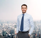 Smiling young and handsome businessman Stock Photography