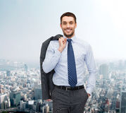 Smiling young and handsome businessman Stock Photos