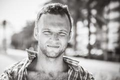 Smiling young handsome Caucasian man, outdoor Stock Photos