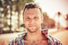 Smiling young handsome Caucasian man in summer Stock Photo