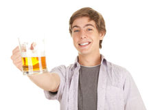 Smiling young handsome man with beer Royalty Free Stock Images