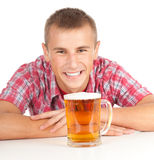 Smiling young handsome man with beer Royalty Free Stock Photography