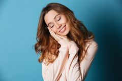 Smiling young happy woman sleeping with eyes closed. Stock Images