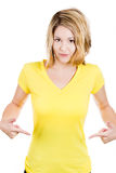 smiling young happy woman, student, pointing at a blank yellow t-shirt Royalty Free Stock Photos