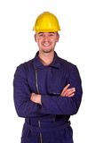 Smiling young heavy industry man. Background Royalty Free Stock Image