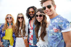 Smiling young hippie friends outdoors Stock Photography