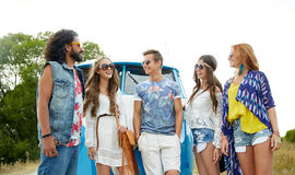 Smiling young hippie friends over minivan car Stock Image