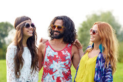 Smiling young hippie friends talking outdoors Royalty Free Stock Photo