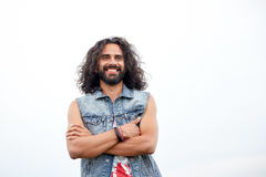 Smiling young hippie man in demin vest Royalty Free Stock Photo