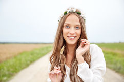 Smiling young hippie woman on cereal field Royalty Free Stock Photography