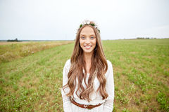 Smiling young hippie woman on cereal field Royalty Free Stock Images