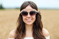Smiling young hippie woman in sunglasses outdoors Royalty Free Stock Photo