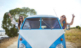 Smiling young hippie women driving minivan car Stock Image