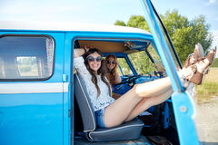Smiling young hippie women resting minivan car Royalty Free Stock Image