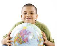 Smiling young hispanic boy with globe Royalty Free Stock Photography