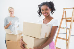 Smiling young housemates moving into new home Stock Photos