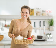 Smiling young housewife with breakfast tray Royalty Free Stock Images