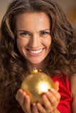 Smiling young housewife holding christmas ball Royalty Free Stock Photo