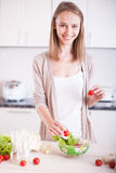 Smiling young housewife Stock Photography
