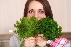 Smiling young housewife mixing fresh salad Stock Image