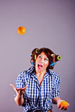 smiling young housewife with oranges Stock Photo