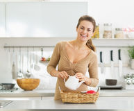 Smiling young housewife serving breakfast tray Royalty Free Stock Photo