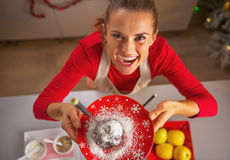 Smiling young housewife showing apple in chocolate glaze Stock Image