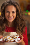 Smiling young housewife showing christmas cookies Stock Image