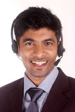Smiling young indian call center executive Royalty Free Stock Photos