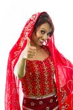 Smiling young Indian woman showing thumb up sign Royalty Free Stock Photos