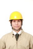 Smiling young Japanese construction worker Stock Photography